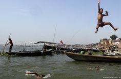 Children dive into the River Ganges in Varanasi, India. Varanasi, also known as Kashi and Benaras, is Hinduism's holiest city. (July 11, 2012)