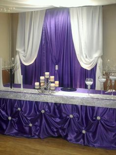 purple satin backdrop and head table designed and decorations by decorative essentials