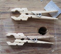 Small clamps made from wooden clothespins.