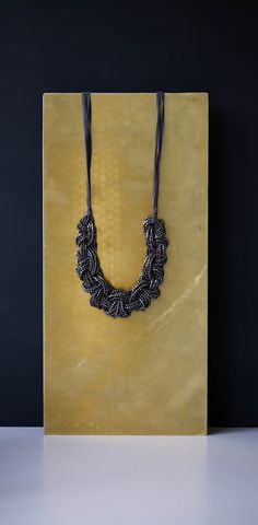 Heavy embellishment is the way forward with our Tala Beaded Plait Suede Necklace. With a beaded plait on a suede thread, this statement necklace elevates your outfit for the evening.