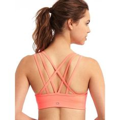 Gap Women Medium Impact Strappy Sports Bra ($30) ❤ liked on Polyvore featuring activewear, sports bras, neon coral, regular, strappy sports bra, gap activewear, gap sports bra, red sports bra and criss cross sports bra