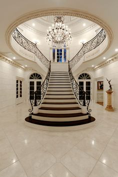 Foyer w/ T-shaped staircase