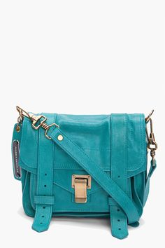 Pebbled leather pouch bag in teal. Gold tone hardware. Fold-over flap with flip-tab and double strap closure. Removable adjustable shoulder strap and logo tag. Exposed pouch pocket under flap. Exposed zip pocket at back. Interior zip pocket and press-stud tab fastening at main compartment. Navy signature Jacquard lining. Approx. 8.5'' length, 4'' width, 7'' depth. 100% leather. Made in Italy.    $1225.00 USD