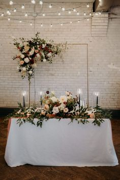 wedding couple Sweetheart reception table with lush floral against white exposed brick wall Romantic Wedding Receptions, Romantic Weddings, Hindu Weddings, Indian Weddings, Destination Weddings, Wedding Wall Decorations, Decoration Table, Reception Table, Wedding Table