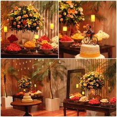 Mesa de doces em laranja , amarelo e madeira.