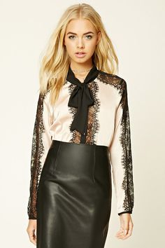 A woven satin lace shirt featuring a self-tie neckline, button front, eyelash lace trim, contrast lining, and long sleeves.
