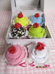 "Great idea for a baby shower gift - onsies or sleepers rolled up and a coffee filter used as the cupcake ""paper cup"" - cute bows for the cherries for girls or little red socks balled up for the cherry for boys!"