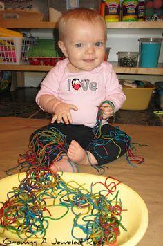 Sensory play ideas for babies- rainbow colored pasta
