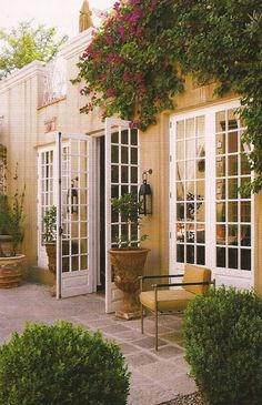 French doors opening up to a stone courtyard - old world style