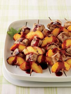 grilled chicken and peach cabobs with blackberry sauce.