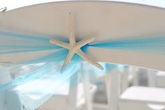 blue and beachy decor :  wedding table linens beach centerpiec Hand Made Tulle And Starfish Chair Decor