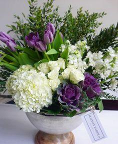 Maison Carola beautiful vintage arrangement; hydrangeas, spray roses, kale, stocks, tulips, myrtle greenery