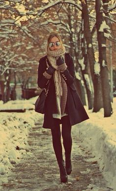 Chunky scarf with a tailored coat, shades and a top knot. My ideal winter outfit. Forget the heels in snow!