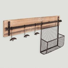 A rustic storage solution for the entryway or mudroom, our wall rack features three aged metal hooks for coats, scarves and backpacks, and a basket for newspapers, hats and tote bags.