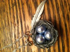 Sweet bird's nest pendant on a sterling silver chain.     ($25)