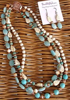 This necklace is an opportunity to bring the feel of summer oceans and beaches with you as we move into Fall. The warmth of the Turquoise & Copper in the 3 strands will bring back your summer memories. Set $62