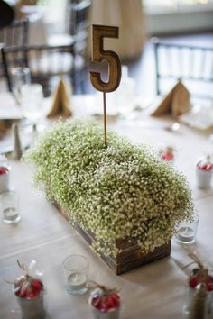 Simple Rustic Centerpiece with Baby's Breath| {Yellow & Slate Blue} Rustic Nautical Summer Wedding|Photographer:  LeAnna Theresa Photography