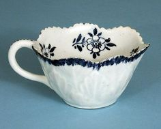 """RARE BOW BUTTER BOAT CIRCA 1765    eBay Superb Bow butter boat moulded as geranium leaf, the interior hand painted in underglaze blue with scattered flowers and leaves.     Height 1.50""""  Length 3.50"""" including handle     Circa 1765     Good condition with minor nibbles to the top rim. No other damage or restoration £280"""