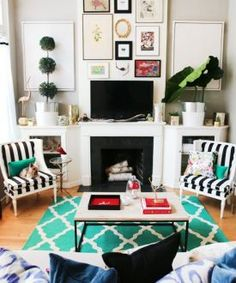 The teal rug is way too swoon-worthy. And those striped chairs? I'm all about it.