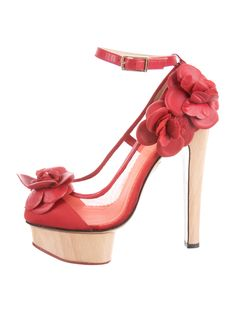 Red mesh Charlotte Olympia pumps with blonde wood heels and platforms, red leather floral adornments at sides and gold-tone buckle closure at ankles.