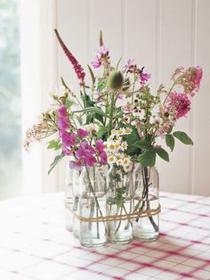Ditch the classic vase and put your flowers in mason jars instead.