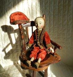 Wooden doll by Alena Sinel