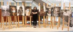 """Andrea Ochoa Pineda with her display of photographs at Bluewater Health on Wednesday. The 23-year-old Lambton College photography student is """"trying to start a conversation"""" about mental health issues through her photographic work. Tyler Kula/Sarnia Observer"""