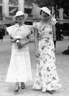 Fashion in 1933: Structured, embellished shoulders complete these delicate looks, which might get you in the mood for a spot of tea and scones.