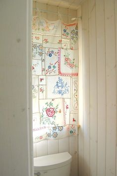 I like this idea; taking doilies, tea towels, and such to make a curtain.