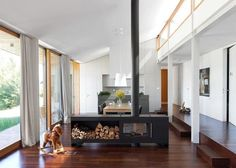 Love the openness and the heat would go everywhere - would probably put down a tile floor under the firebox