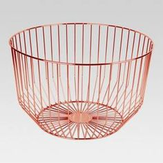 The simple, open frame of this Round Wire Basket from Project 62™ doubles as both storage and display, as whatever you keep in it can show off your style. Its copper finish gives contents an extra polish, whether they're craft supplies or stuffed animals. The straight lines and modern angles make this basket easy to look at and design around.<br><br>1962 was a big year. Modernist design hit its peak and moved into homes across the country. And in Minnesota, Target was...