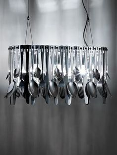 Chrome pendant lamp HUNGRY by @Fabbian | #design Ali Siahvoshi #Cutlery