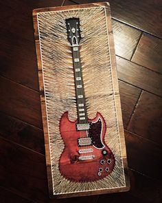 Gibson SG electric guitar done in string art. This is a very large piece, approximately 14 wide x 33 tall. Each piece will vary some due to wood and supplies. The wood will distressed along the edges. Please contact us for free local pickup. Learn Acoustic Guitar, Acoustic Guitar Strings, Guitar Art, Acoustic Guitars, String Art Diy, Colchas Quilt, Guitar Vector, Fender Vintage, String Art Patterns