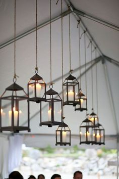 These hanging lanterns remind me of the floating candles in the Great Hall. Not necessarily this style, but I like the idea of hanging candles in tent. Wedding Tent Decorations, Tent Wedding, Wedding Events, Wedding Day, Wedding Reception, Wedding Table, Wedding Window, Wedding Photos, Light Wedding