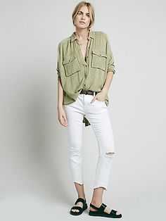 Distressed skinny crop jeans with destroyed tears at each knee.