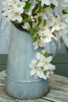 blossoms in enamelware...
