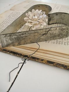 Old cookie cutter with book pages as a background and a drop cloth/burlap rose would be cool.