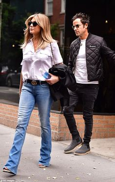 Her man: The siren and her husband Justin seen in New York City in September. Here she also happens to be carrying a bottle of SmartWater