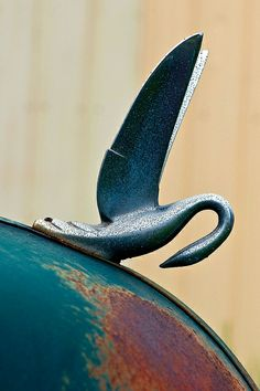 Graceful hood ornament by janet little, via Flickr