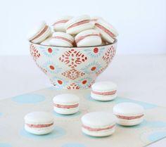 Vanilla bean macarons with raspberry buttercream