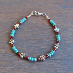 Beaded Turquoise Bracelet, Silver Flower Bracelet, Womens Bracelet, Boho Chic Beaded Bracelet, Stacking Bracelet, Bohemian Style Bracelet Playful and fun with a boho chic style, this new bracelet by Tam Davis is full of casual charm. Genuine turquoise and coral are mixed with silver