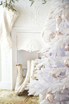 An old antique cast iron fireplace serves as a focal point most of the time but of course, during Christmas- the tree takes center stage.