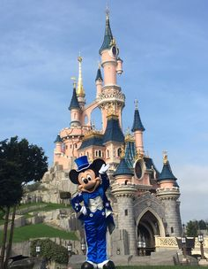 Mickey near by the castle in his 25 Anniversary outfit at Disneyland Paris