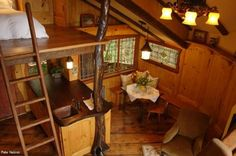 Heidi treehouse interior from Tree House Masters.  What a beautiful kitchen!  What a fun guest house that would be! #treehouses #treehousemasters