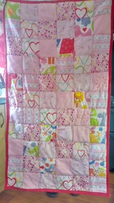 This patchwork quilt is for a baby's cot or a small child's bed. Can be sold as is or as a set with two small matching cushions £57.00 on it's own or £70.00 for set.