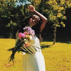Open field girl with flowers