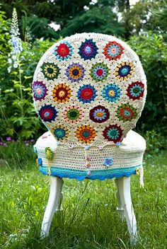 Such a cool way to cover an old chair with a good shape, but with bad upholstery! Crocheted Granny circles in bright colors make a modern room feel cozy chic!!  |About Mo and me: Finished that project|