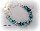 Trina's beautiful collectiom with my beads necklace
