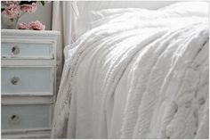 white on white on white. Love. And a hint of aqua in the bed stand.