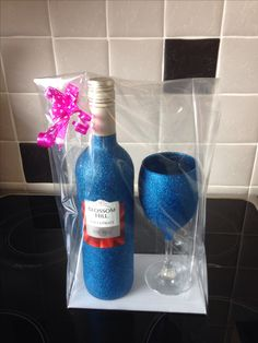 Glittered wine bottle and glass